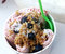 Strawberry ice roll sundae with granola, berries and coconut