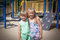 Two sisters on playground.