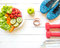 Healthy lifestyle for women diet with sport equipment, sneakers, measuring tape, vegetable fresh, green apples and bottle of water
