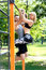 Young attractive couple doing pull-ups exercises on crossbar in