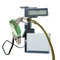 Green gas nozzle pouring fuel