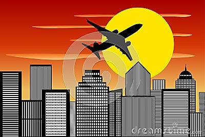 飞机剪影上升的日落都市风景