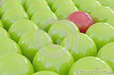 Één verschillende bal die van de menigte duidelijk uitkomt