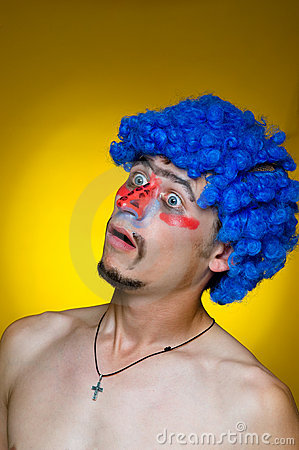 Сlown in a blue wig, expressing surprise