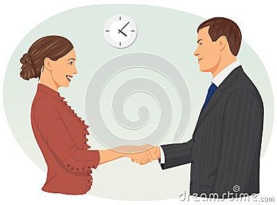 商人和女实业家握手在办公室.图片