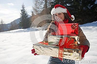 Γυναίκα Χριστουγέννων με τα δώρα