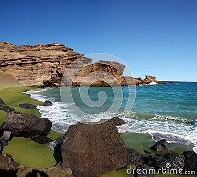 πράσινη άμμος παραλιών