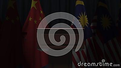 Σημαίες της Κίνας και της Μαλαισίας και ομιλητής ποντίον Απεικόνιση 3D σχετικά με το πολιτικό γεγονός ή τις διαπραγματεύσεις φιλμ μικρού μήκους