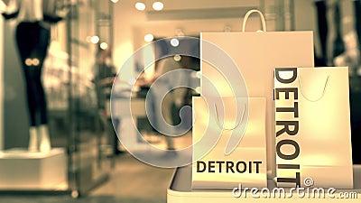 Χάρτινες σακούλες αγορών με λεζάντα Ντιτρόιτ ενάντια στην θολή είσοδο καταστήματος Λιανικό εμπόριο στις Ηνωμένες Πολιτείες φιλμ μικρού μήκους