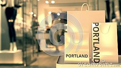 Χάρτινες σακούλες αγορών με λεζάντα Portland ενάντια στην θαμπή είσοδο καταστήματος Το λιανικό εμπόριο στις Ηνωμένες Πολιτείες σχ φιλμ μικρού μήκους