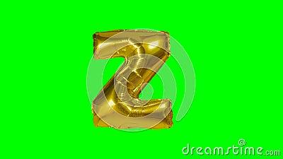 Большое письмо z от воздушного шара золота гелия алфавита плавая на зеленый экран - акции видеоматериалы