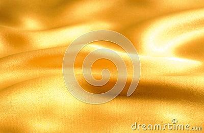 волна ткани золотистая