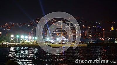 Город празднично освещен ночью в Ялте 4к сток-видео
