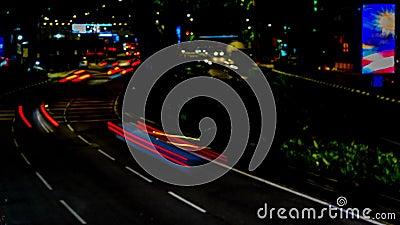 Движение в городе Промежуток времени бульвара 4K, ноча Пропускать плотного движения с запачканным движением сумрак акции видеоматериалы