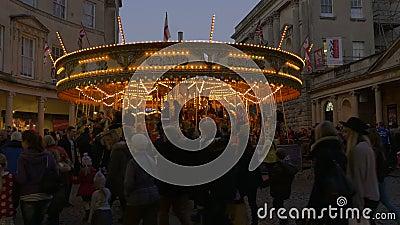 Занятые покупатели с Carousel в предпосылке видеоматериал