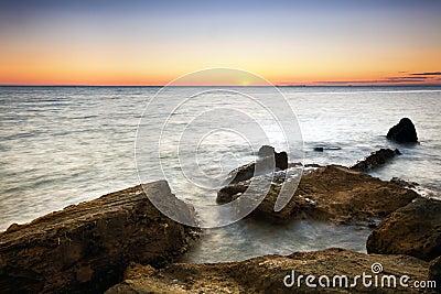 заход солнца залива