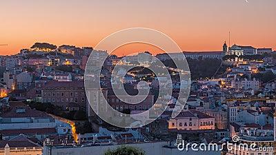Лиссабонская авиакомпания Cityscape ночует в ночное время суток, начиная с точки зрения Святого Петра Алькантара, Португалия акции видеоматериалы