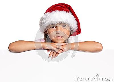 Маленькая девочка в шлеме Санта
