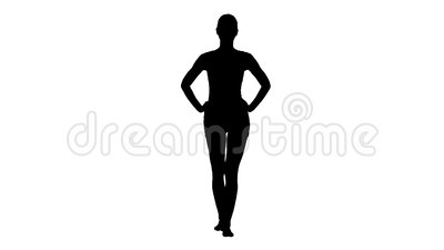 Пригонка силуэта и sporty девушка в белый идти нижнего белья босоногий с руками на ее бедрах видеоматериал