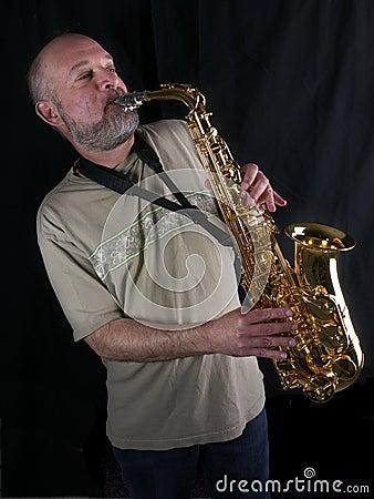 саксофон игрока