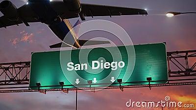 Самолет принимает Сан-Диего во время чудесного восхода солнца сток-видео