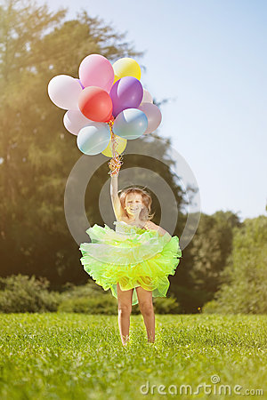 Сhild with a bunch of balloons in their hands