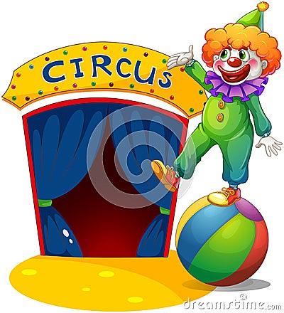 一个小丑在提出马戏房子的球顶部