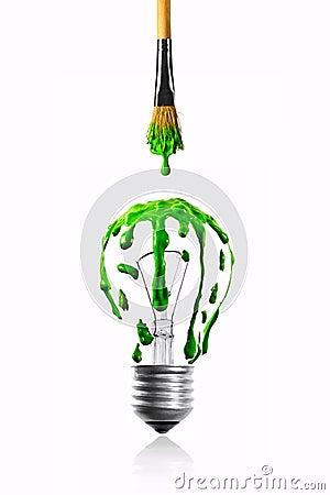从油漆刷的颜色水滴到电灯泡