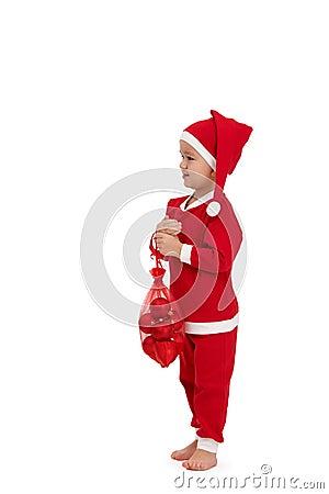 作为圣诞老人穿戴的逗人喜爱的孩子