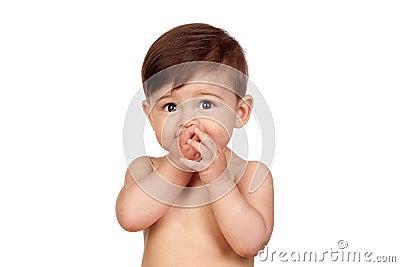 可爱的女婴用在她的嘴的现有量