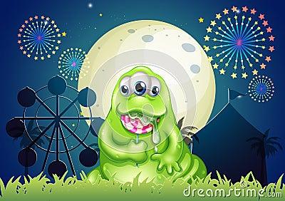 吃棒棒糖的妖怪在游乐园图片