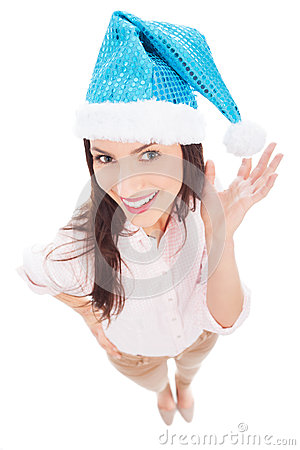 圣诞老人帽子的可爱的妇女