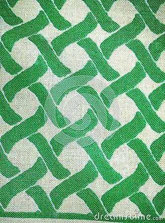 在绿色和白色的被编织的棉纺织品
