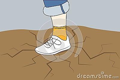 在一双运动鞋的人脚在与镇压的地面上.图片