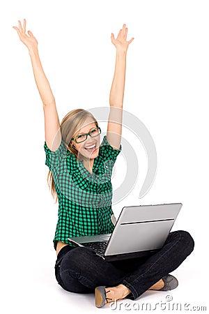 女孩膝上型计算机