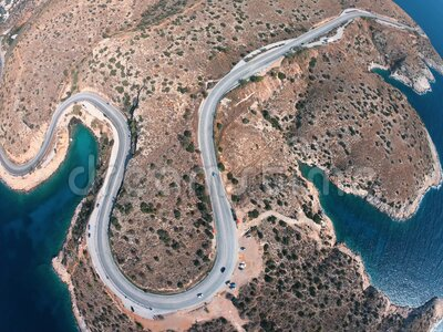 希腊海滨无人机翻转弯道,水绿石,海浪 影视素材