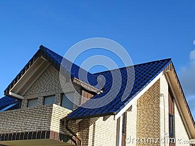 波形别墅新的瓦屋房子顶.餐厅双蓝色图片