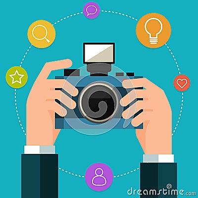 手中照片的照相机 平的样式