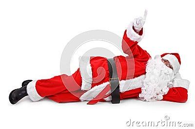 在手指之上他他的指向圣诞老人的对象.图片