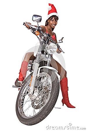 骑自行车盖帽头发查出的长的红色乘坐的圣诞老人白人妇女.图片