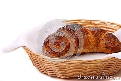 新月形面包的图象与鸦片的在篮子。