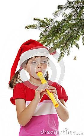 有圣诞老人盖帽playin的小女孩长笛