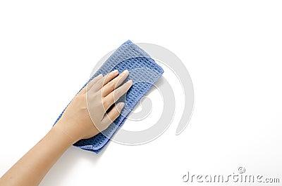 垂悬与在白色背景的蓝色旧布清洁.图片