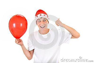 有红色气球的愉快的少年