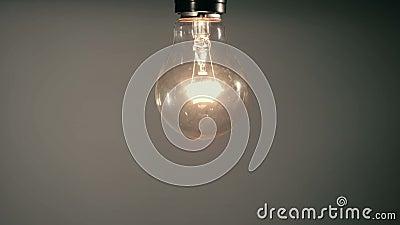 灯座上用手拧旧爱迪生灯泡 股票视频