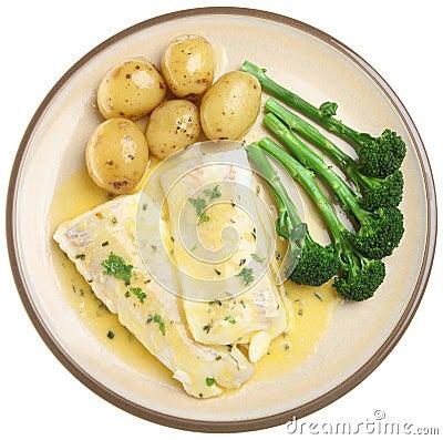 被烘烤的内圆角钓鱼黑线鳕蔬菜