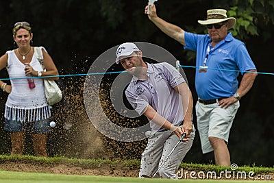 高尔夫球能手雍容沙子射击。 编辑类库存照片