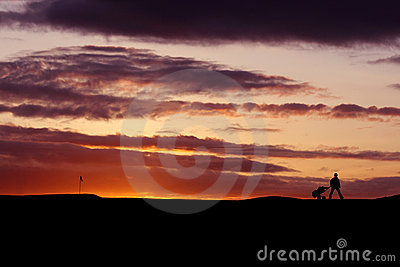 高尔夫球运动员日落