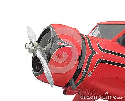 飞机的星形�yb�9�._一架小的红色飞机的前面的特写镜头与一台星形发动机的,显示引擎