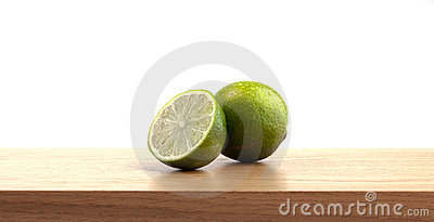 1 and a half lime on wooden plank.